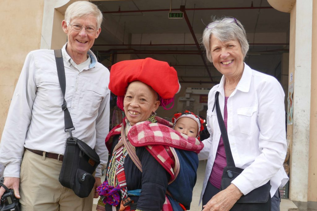 Jim And Karen With Local Woman And Baby In Vietnam 2